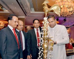 Telecommunications and Digital Infrastructure Minister Harin Fernando lights the oil lamp at the opening of Cyber Security Summit as International Telecommunication Union Asia Pacific Senior Advisor Sameer Sharma (left), co organiser CICRA Consultancies CEO and Director Boshan Dayaratne (second from right) and co-organiser Daily FT Editor Nisthar Cassim look on - Pix by Bhanuka Kirinde, Upul Abayasekara and Daminda Harsha Perera