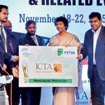 ICTA Sri Lanka making a token presentation as APICTA 2015 National partner (from left) FITIS Chairman Chinthaka Wijewickrama, APICTA 2015 Co- Chairman Abbas Kamrudeen, University of Colombo School of Computing Director Prof. Gihan Wickramanayake, APICTA 2015 Co-Chairman Ruwan Amarasekera, ICTA Chairperson Chitranganie Mubarak and ICTA CEO Muhunthan Canagey
